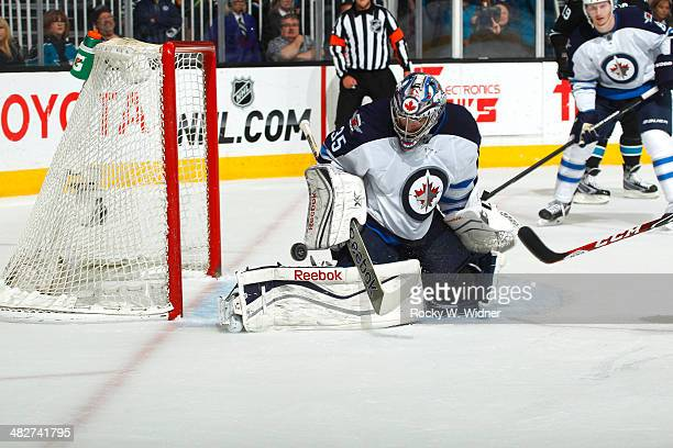 Al Montoya of the Winnipeg Jets makes a save against the San Jose Sharks at SAP Center on March 27 2014 in San Jose California