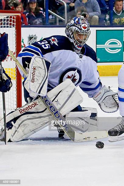 Al Montoya of the Winnipeg Jets makes a save during the game against the Columbus Blue Jackets on December 16 2013 at Nationwide Arena in Columbus...