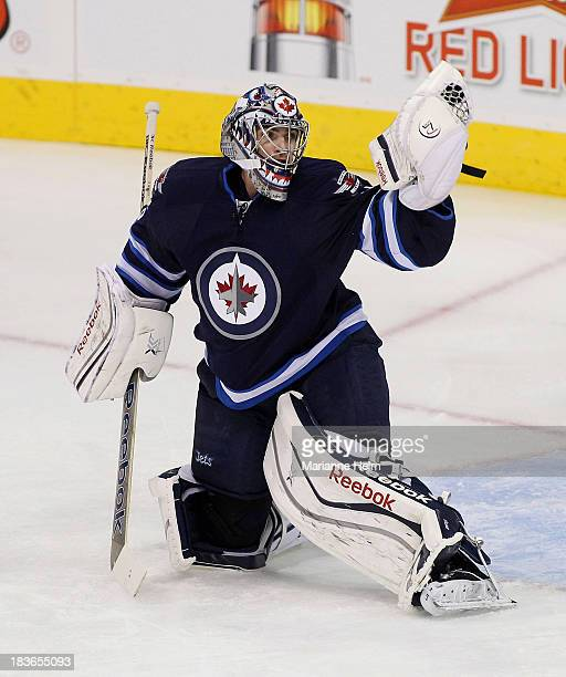 Al Montoya of the Winnipeg Jets makes a save during warmup before an NHL home opener game against the Los Angeles Kings at the MTS Centre on October...