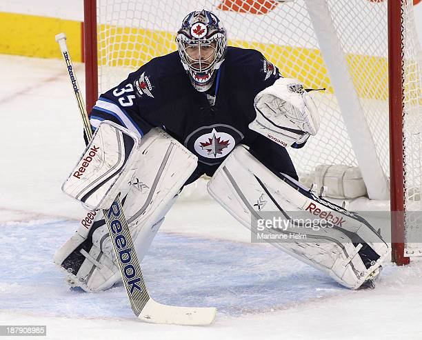 Al Montoya of the Winnipeg Jets protects his net during firstperiod action in an NHL game against the Detroit Red Wings at the MTS Centre on November...