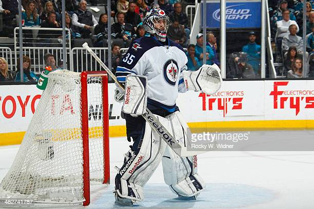 Al Montoya of the Winnipeg Jets protects the net against the San Jose Sharks at SAP Center on March 27 2014 in San Jose California
