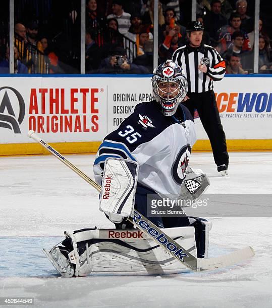 Al Montoya of the Winnipeg Jets skates against the New York Islanders at the Nassau Veterans Memorial Coliseum on November 27 2013 in Uniondale New...