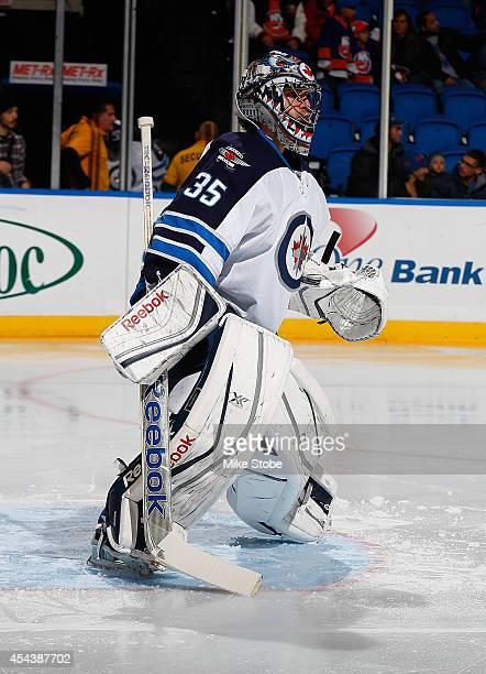 Al Montoya of the Winnipeg Jets skates against the New York Islanders at Nassau Veterans Memorial Coliseum on November 27 2013 in Uniondale New York...
