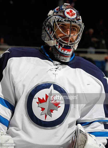 Al Montoya of the Winnipeg Jets skates during warmups prior to the game against the New York Islanders at Nassau Veterans Memorial Coliseum on April...