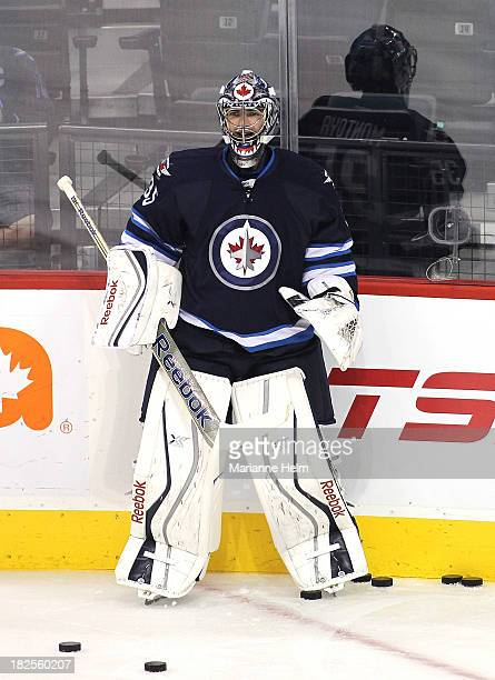 Al Montoya of the Winnipeg Jets smiles as he waits his turn in net during warmup before an NHL preseason game against the Boston Bruins at the MTS...