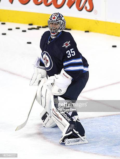Al Montoya of the Winnipeg Jets smiles during warmup before an NHL preseason game against the Boston Bruins at the MTS Centre on September 26 2013 in...