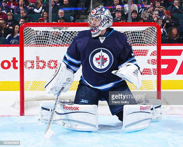 Al Montoya of the Winnipeg Jets stretches in the crease prior to puck drop against the New York Islanders at the MTS Centre on January 27 2013 in...