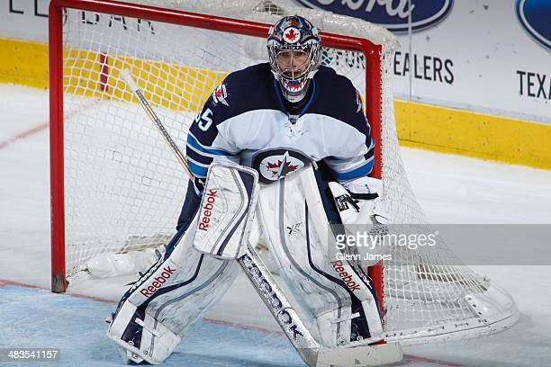 Al Montoya of the Winnipeg Jets tends goal against the Dallas Stars at the American Airlines Center on March 24 2014 in Dallas Texas