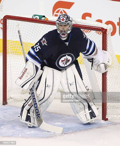 Al Montoya of the Winnipeg Jets tends goal during firstperiod action in an NHL game against the New Jersey Devils at the MTS Centre on October 13...