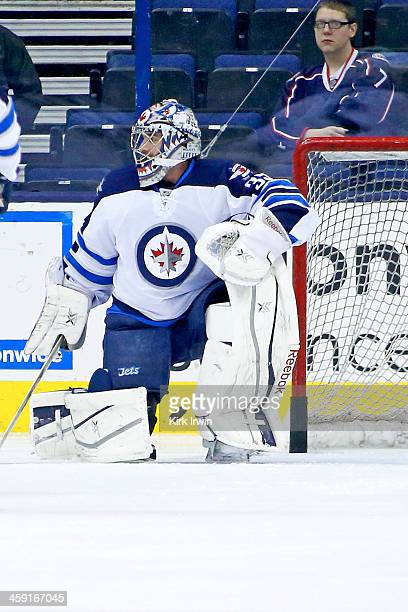 Al Montoya of the Winnipeg Jets warms up prior to the start of the game against the Columbus Blue Jackets on December 16 2013 at Nationwide Arena in...