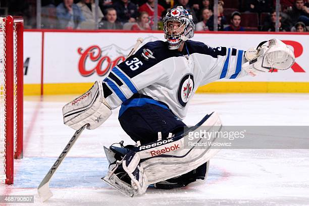 Al Montoya of the Winnipeg Jets watches the puck go wide during the NHL game against the Montreal Canadiens at the Bell Centre on February 2 2014 in...