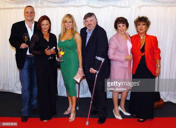 Al Murray Belinda Carlise Abi Titmuss Roger Cook Edwina Currie and Amanda Barry pose for the cameras at reality television program 'Hell's Kitchen'...