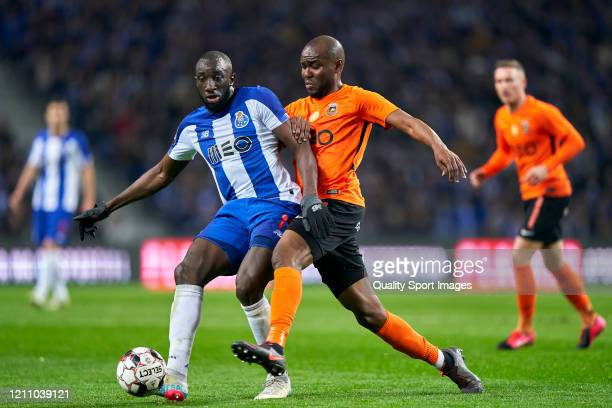 Al Musrati of Rio Ave FC competes for the ball with Moussa Marega of FC Porto during the Liga Nos match between FC Porto and Rio Ave FC at Estadio do...