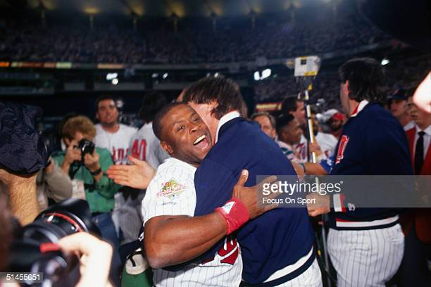 Al Newman hugs Jack Morris of the Minnesota Twins in the celebration after winning Game Seven of the World Series against the Atlanta Braves at the...
