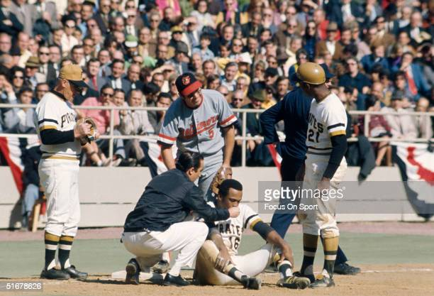 Al Oliver of the Pittsburgh Pirates gets some help from the trainer during the World Series at Three Rivers Stadium on October 1971 in Pittsburgh...