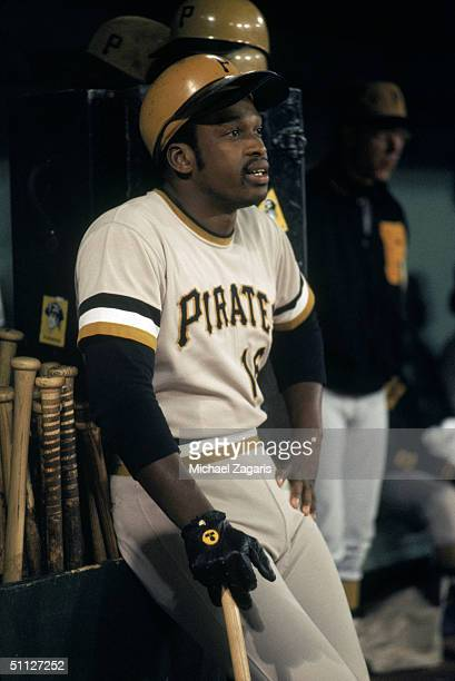Al Oliver of the Pittsburgh Pirates sits against the bat rack inside the dugout during a game circa July of the 1973 MLB season Al Oliver played for...