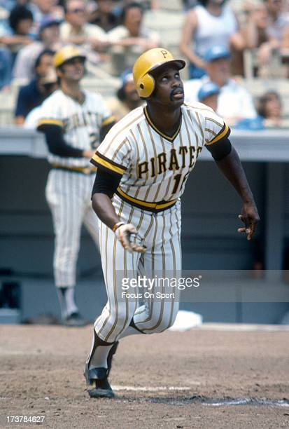 Al Oliver of the PIttsburgh Pirates watches the flight of his ball as he runs towards first base against the New York Mets during an Major League...