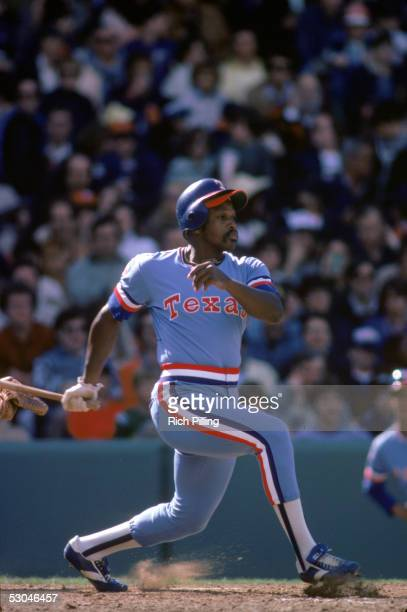 Al Oliver of the Texas Rangers heads toward first as he watches the flight of his hit during a game at Fenway Park in Boston Massachusetts