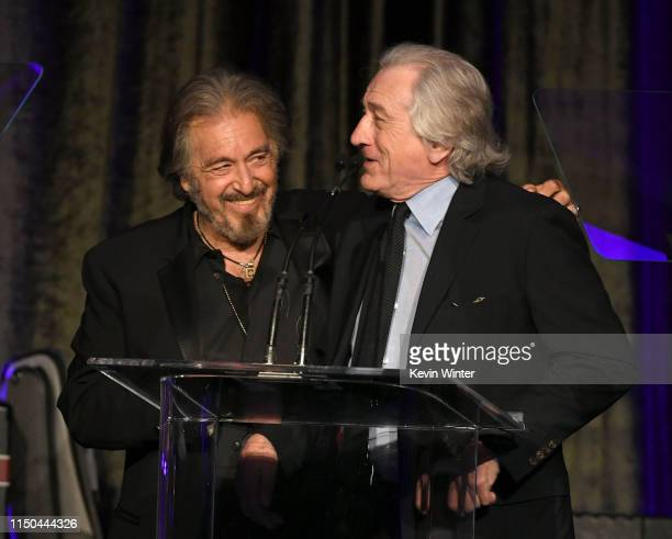 Al Pacino accepts the American Icon Award from Robert De Niro onstage at the American Icon Awards at the Beverly Wilshire Four Seasons Hotel on May...