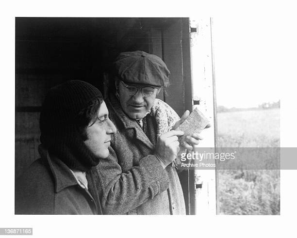 Al Pacino and Gene Hackman looking out a door and seeing a field in a scene from the film 'Scarecrow' 1973