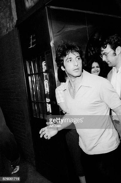 Al Pacino coming out onto the street; circa 1970; New York
