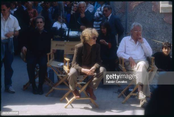 Al Pacino Diane Keaton and cinematographer Gordon Willis take a break during the filming of Francis Ford Coppola's 1990 film The Godfather Part III...