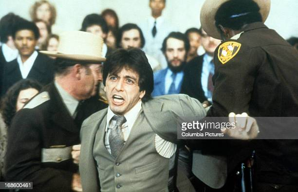 Al Pacino is pulled away in court in scene from the film 'And Justice For All' 1979