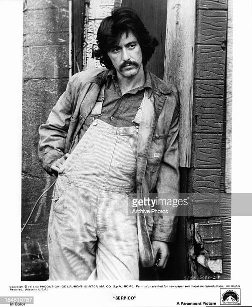 Al Pacino leans against a building in a scene from the film 'Serpico' 1973