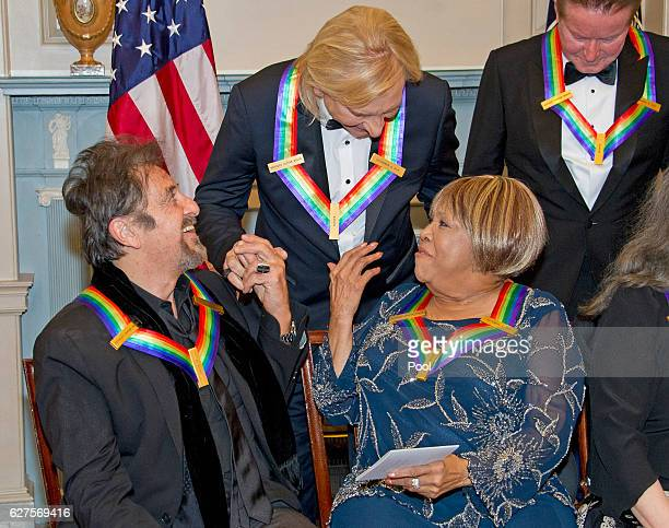 Al Pacino left one of the five recipients of the 39th Annual Kennedy Center Honors gospel and blues singer Mavis Staples right and Joe Walsh of the...