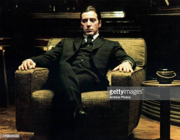 Al Pacino sits in a chair in a scene from the film 'The Godfather Part II' 1974