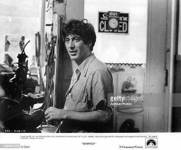 Al Pacino standing in a shoe repair store in a scene from the film 'Serpico' 1973