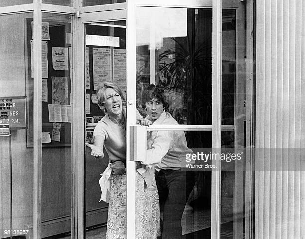 Al Pacino turns bank robber in the film 'Dog Day Afternoon' 1975 Here he pulls Penelope Allen back into the bank as she gestures wildly