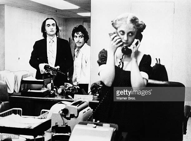 Al Pacino turns bank robber in the film 'Dog Day Afternoon' 1975 Here he and John Cazale listen to Carol Kane make a phonecall