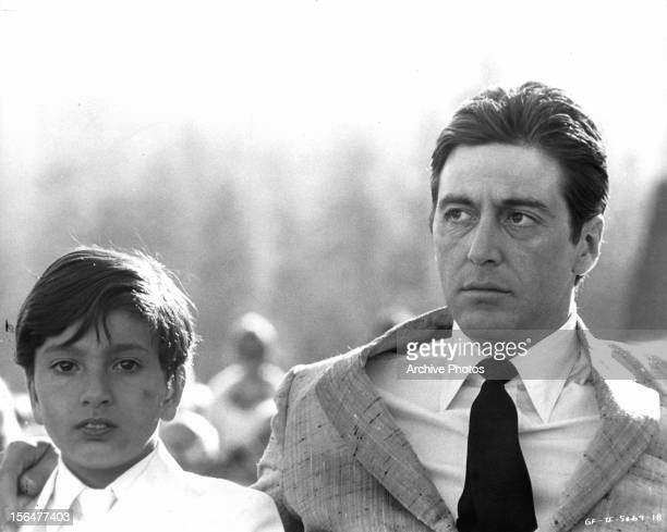 Al Pacino with child in a scene from the film 'The Godfather Part II' 1974
