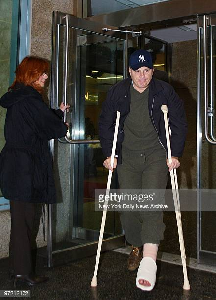 Al Petraglia who was wounded in the foot during a shooting at Rao's restaurant in East Harlem leaves Metropolitan Hospital accompanied by his wife...