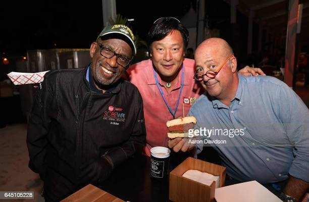 Al Roker Ming Tsai and Andrew Zimmern attend during the South Beach Wine Food Festival's Heineken Light Burger Bash where Al Roker's booth served the...
