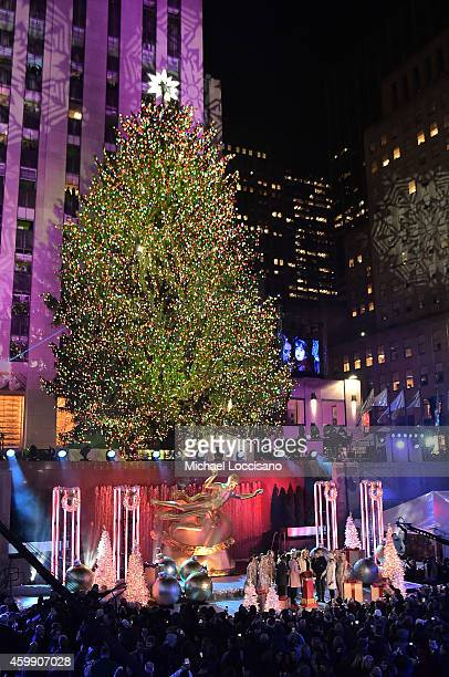 Al Roker Savannah Guthrie Cyndi Lauper Billy Porter Matt Lauer and Natalie Morales appear with the Rockettes on stage at the 82nd annual Rockefeller...