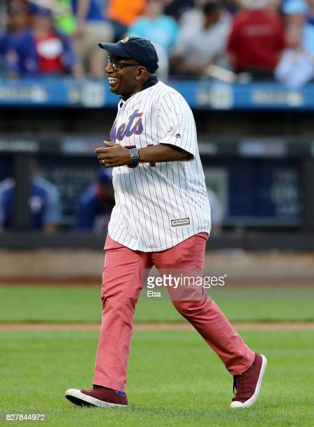Al Roker smiles after he throws out the ceremonial first pitch before the game between the New York Mets and the Texas Rangers during interleague...