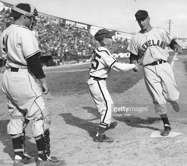 APR 1 1953 APR 2 1953 Al Rosen Cleveland Indian's third baseman steps on home plate after blasting Sal Maglie's first pitch over the center field...