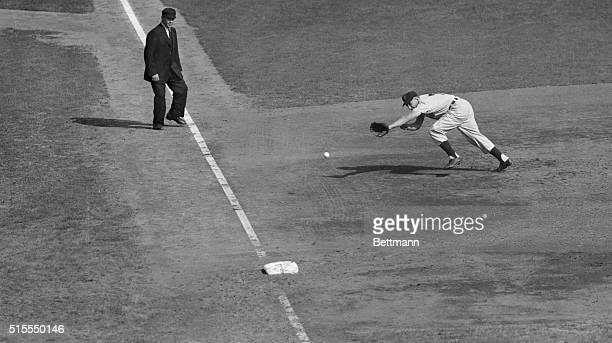 Al Rosen of the Cleveland Indians is doing a mighty stretch in an attempt to reach the ball as Wes Westrum slashed a bounding single into the left...