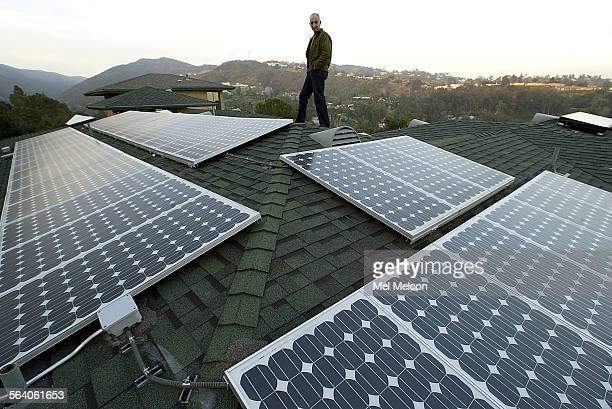 Al Rosen stands on roof of his home in Brentwood where photo voltaic panels are used to generate electricity from the sun Digital image taken on...