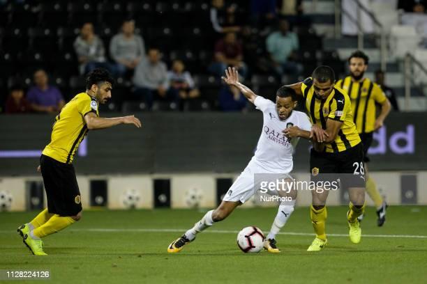 Al Sadd defender Hamid Ismail tussles for possession with Qatar SC midfielder Dodo at the Jassim bin Hamad Stadium in Doha Qatar on Thursday 28...