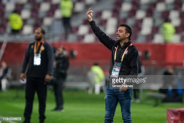 Al Sadd manager, Xavi, gives orders to his players during the FIFA Club World Cup match between Al Sadd and Esperance Sportive de Tunis at Khalifa...