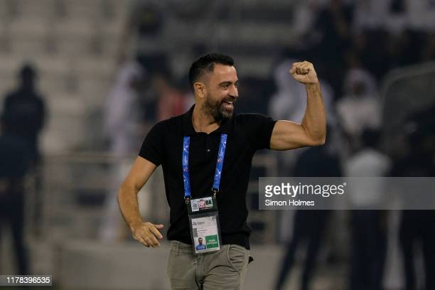 Al Sadd manager Xavi Hernandez celebrates a goal during the first leg of the AFC Champions League semi finals between Al Sadd and AlHilal at the...
