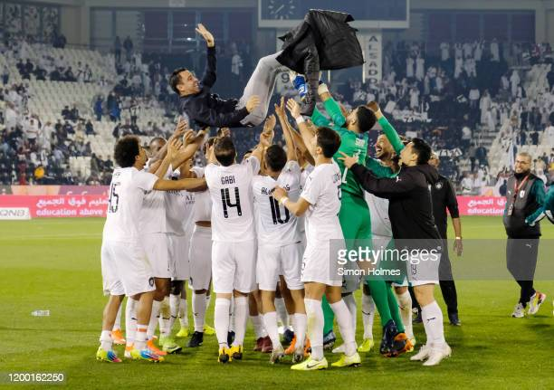 Al Sadd manager Xavi Hernandez is thrown in the air in celebration by his players after winning the Qatar Cup against Al Duhail at Jassim Bin Hamad...