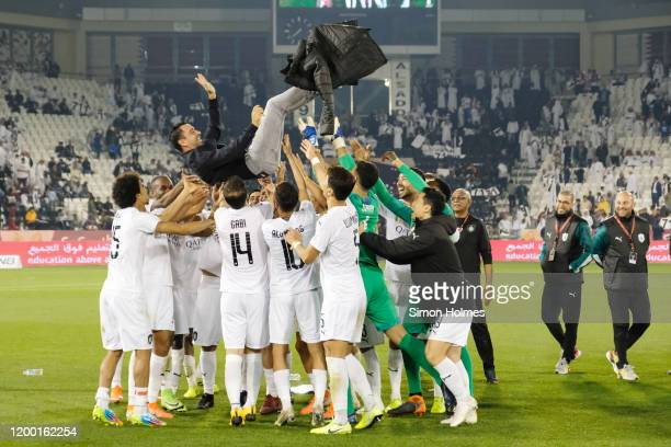 Al Sadd manager, Xavi Hernandez, is thrown in the air in celebration by his players after winning the Qatar Cup against Al Duhail at Jassim Bin Hamad...
