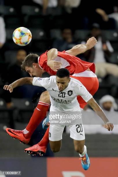 Al Sadd's Salem Al Hajri fights for the ball with Persepolis' Mario Budimir during the AFC champions league Group D football match between Qatar's Al...