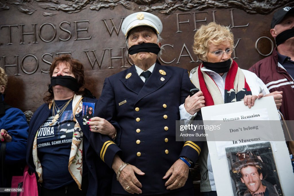 Al Santora (C), father of Christopher Santora, a victim of the September 11, 2001 attack, and other victim's family members protest the decision by city officials to keep unidentified human remains of the 9-11 victims at the 9-11 Museum at the World Trade Center site, on May 10, 2014 in New York City. The decision by city officials to keep the remains at the museum until they are able to be identified has drawn both support and criticism by families of victims. The remains were moved early this morning from the medical examiner's repository to the 9-11 Museum.