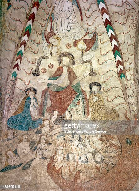 Al secco murals depicting Jesus Christ with angels saving people from the devil and death in the medieval St Lawrence Church in Lohja Finland