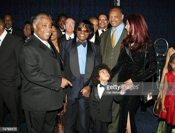 Al Sharpton James Brown and son James Jr Jesse Jackson and Tomi Rae Hynie at the Sheraton Hotel in New York City New York